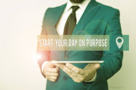 Writing note showing Start Your Day On Purpose. Business concept for Have clean ideas of what you are going to do Businessman in blue suite with a tie holds lap top in hands