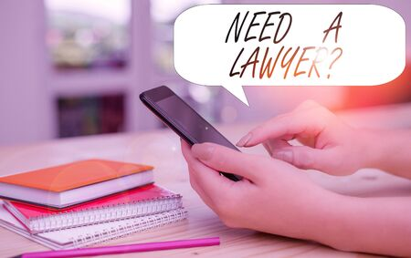 Conceptual hand writing showing Need A Lawyer Question. Concept meaning Legal problem Looking for help from an attorney woman using smartphone and technological devices inside the home 스톡 콘텐츠 - 131345234