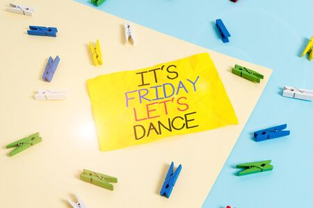Handwriting text writing It S Friday Let S Dance. Conceptual photo Celebrate starting the weekend Go party Disco Music Colored clothespin paper empty reminder yellow blue floor background office
