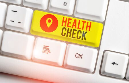 Text sign showing Health Check. Business photo showcasing thorough physical examination A medical checkup of oneself White pc keyboard with empty note paper above white background key copy space