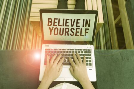 Writing note showing Believe In Yourself. Business concept for common piece of advice that you can do everything woman laptop computer office supplies technological devices inside home