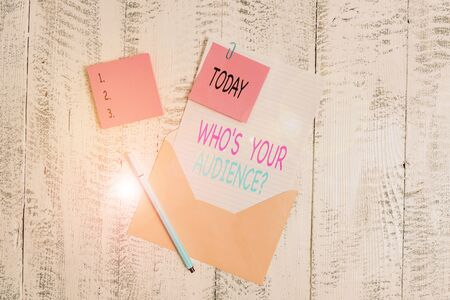 Conceptual hand writing showing Who S Your Audience Question. Concept meaning asking someone about listeners category Coaching Envelope blank sheet sticky note ballpoint wooden background
