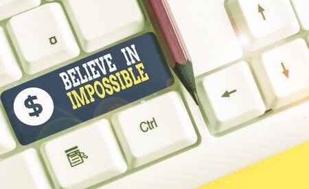 Word writing text Believe In Impossible. Business photo showcasing You can do it everything is possible Work hard White pc keyboard with empty note paper above white background key copy space Stok Fotoğraf