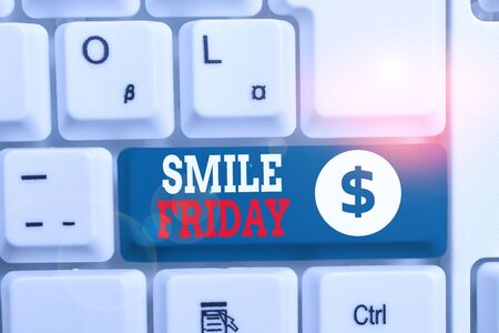 Writing note showing Smile Friday. Business concept for used to express happiness from beginning of fresh week White pc keyboard with note paper above the white background