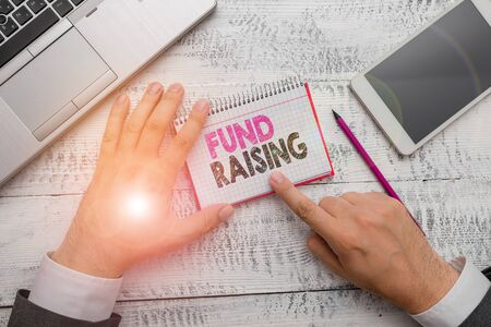 Handwriting text Fund Raising. Conceptual photo the act of seeking to generate financial support for a charity Stock Photo