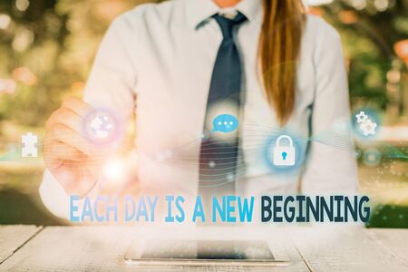Conceptual hand writing showing Each Day Is A New Beginning. Concept meaning Every morning you can start again Inspiration Female human wear formal work suit presenting smart device