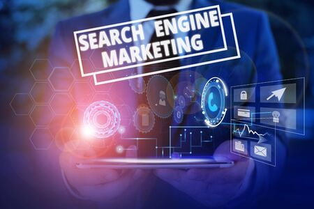 Conceptual hand writing showing Search Engine Marketing. Concept meaning promote Website visibility on searched result pages Male wear formal suit presenting presentation smart device
