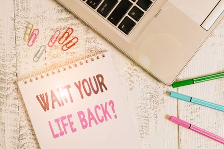 Handwriting text Want Your Life Back Question. Conceptual photo Have again our Lives Take Control of our Being Slim metallic laptop blank spiral notepad pens clips lying wooden table