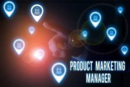 Writing note showing Product Marketing Manager. Business concept for who responsible for putting plan to sell product Male wear formal work suit presenting presentation smart device