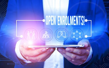 Text sign showing Open Enrolments. Business photo text when employees may make changes to elected fringe benefit Male human wear formal work suit presenting presentation using smart device