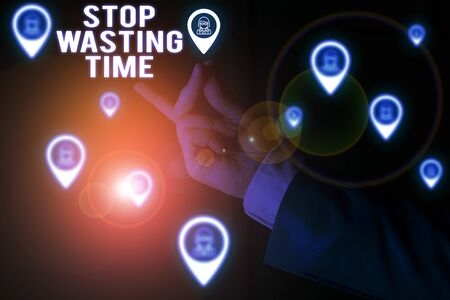 Text sign showing Stop Wasting Time. Business photo showcasing advising demonstrating or group start planning and use it wisely Male human wear formal work suit presenting presentation using smart device
