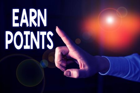 Writing note showing Earn Points. Business concept for getting praise or approval for something you have done Finger pointing in the Dark with hand pointing in the copy space