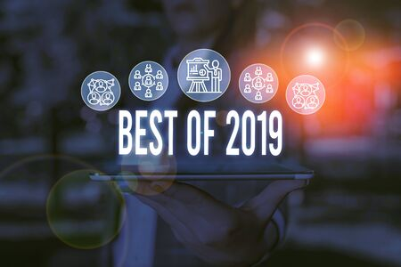 Handwriting text Best Of 2019. Conceptual photo great and marvelous things and events happened on 2019 Woman wear formal work suit presenting presentation using smart device 版權商用圖片