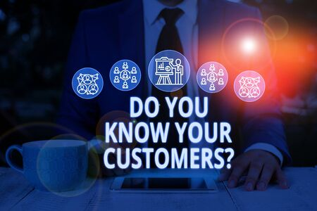 Text sign showing Do You Know Your Customers question. Business photo text asking to identify a customer s is nature Male human wear formal work suit presenting presentation using smart device