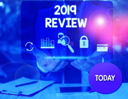 Text sign showing 2019 Review. Business photo text New trends and prospects in tourism or services for 2019 man icons smartphone speech bubble office supplies technological device