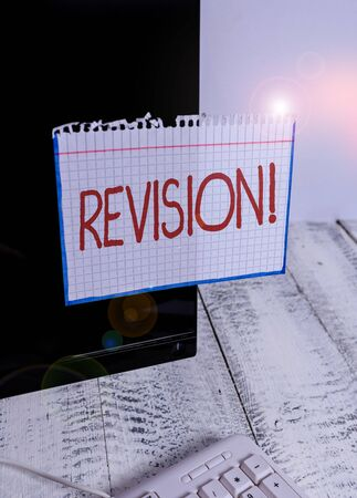 Text sign showing Revision. Business photo text action of revising over someone like auditing or accounting Notation paper taped to black computer monitor screen near white keyboard Stock Photo