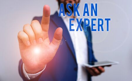 Conceptual hand writing showing Ask An Expert. Concept meaning consult someone who has skill about something or knowledgeable Businessman with pointing finger in front of him