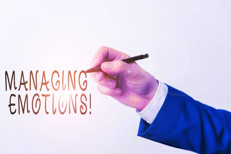 Text sign showing Managing Emotions. Business photo showcasing ability be open to feelings and modulate them in oneself Isolated hand above white background. Pointing pen in the hand on white backgrou