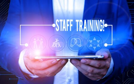 Text sign showing Staff Training. Business photo text learn specific knowledge improve perforanalysisce in current roles Male human wear formal work suit presenting presentation using smart device
