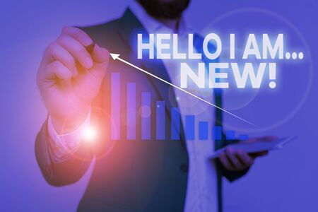 Writing note showing Hello I Am New. Business concept for used as greeting or to begin telephone conversation Male wear formal work suit presenting presentation smart device