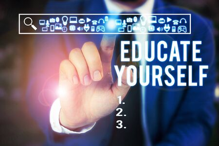 Word writing text Educate Yourself. Business photo showcasing prepare oneself or someone in a particular area or subject Male human wear formal work suit presenting presentation using smart device