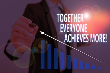 Text sign showing Together Everyone Achieves More. Business photo text Members create synergy with strong sense mutual commitment Woman wear formal work suit presenting presentation using smart device Stok Fotoğraf