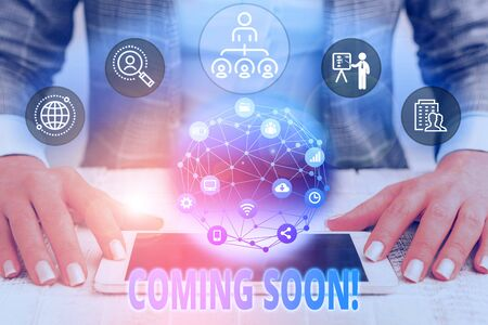 Word writing text Coming Soon. Business photo showcasing event or action that will happen after really short time Female human wear formal work suit presenting presentation use smart device