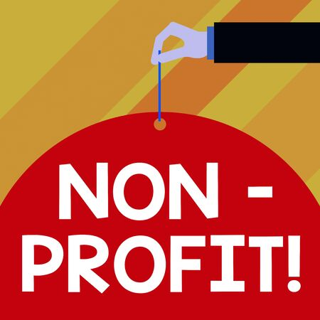 Writing note showing Non Profit. Business concept for not making or conducted primarily to make profit organization Male hand arm needle punching big blank balloon geometrical background Stok Fotoğraf