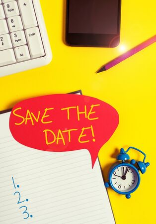 Text sign showing Save The Date. Business photo showcasing Organizing events well make day special event organizers Empty red bubble paper on the table with pc keyboard