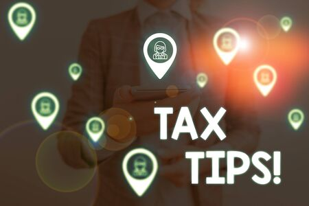 Handwriting text writing Tax Tips. Conceptual photo compulsory contribution to state revenue levied by government Woman wear formal work suit presenting presentation using smart device