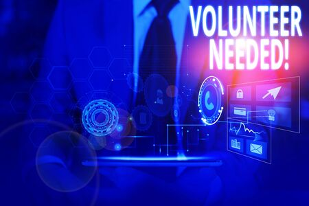 Writing note showing Volunteer Needed. Business concept for asking demonstrating to work for organization without being paid Male wear formal suit presenting presentation smart device