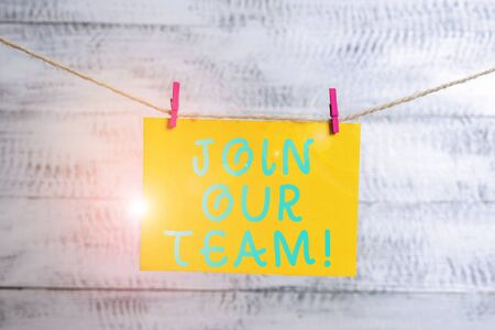 Conceptual hand writing showing Join Our Team. Concept meaning inviting someone into your local group or company Clothespin rectangle shaped paper reminder white wood desk