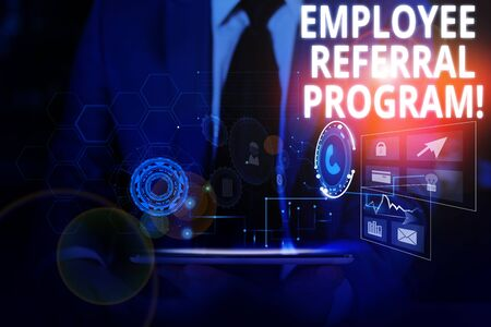 Writing note showing Employee Referral Program. Business concept for internal recruitment method employed by organizations Male wear formal suit presenting presentation smart device Фото со стока