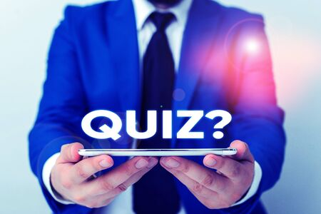 Handwriting text writing Quiz Question. Conceptual photo test of knowledge as competition between individuals or teams Businessman in blue suite with a tie holds lap top in hands