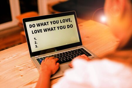 Conceptual hand writing showing Do What You Love Love What You Do. Concept meaning Pursue your dreams or passions in life woman with laptop smartphone and office supplies technology 版權商用圖片