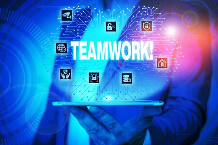 Text sign showing Teamwork. Business photo text combined action of group especially when effective and efficient Male human wear formal work suit presenting presentation using smart device