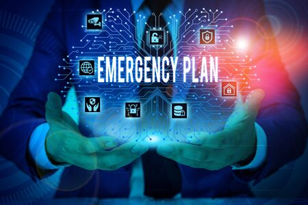 Text sign showing Emergency Plan. Business photo showcasing procedures for handling sudden or unexpected situations Male human wear formal work suit presenting presentation using smart device