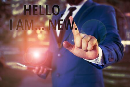 Word writing text Hello I Am New. Business photo showcasing introducing oneself in a group as fresh worker or student Businessman with pointing finger in front of him