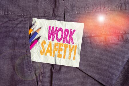 Text sign showing Work Safety. Business photo showcasing policies and procedures in place to ensure health of employees Writing equipment and white note paper inside pocket of man work trousers
