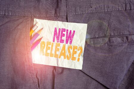 Text sign showing New Release Question. Business photo showcasing asking about recent product or service newly unleashed Writing equipment and white note paper inside pocket of man work trousers Stock fotó - 131600524