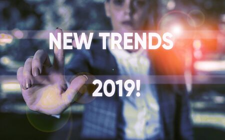 Word writing text New Trends 2019. Business photo showcasing general direction in which something is developing Business woman in the nature pointing with the finger into empty space