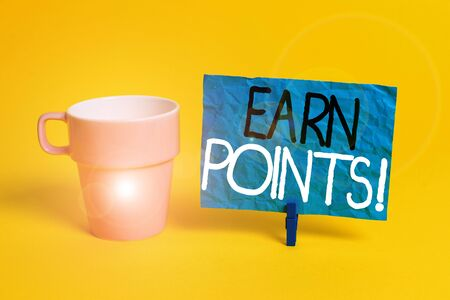 Handwriting text Earn Points. Conceptual photo collecting scores in order qualify to win big prize Cup empty paper blue clothespin rectangle shaped reminder yellow office Stok Fotoğraf