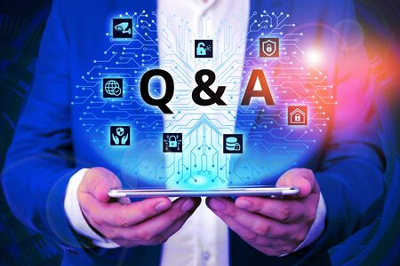 Handwriting text writing Q And A. Conceptual photo defined as questions being asked and answers Male human wear formal work suit presenting presentation using smart device