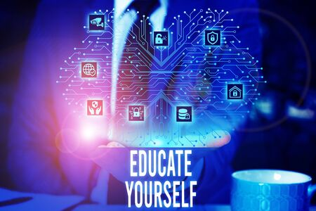 Handwriting text Educate Yourself. Conceptual photo prepare oneself or someone in a particular area or subject Male human wear formal work suit presenting presentation using smart device