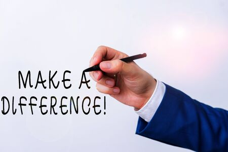 Text sign showing Make A Difference. Business photo showcasing have significant effect or non on demonstrating or situation Isolated hand above white background. Pointing pen in the hand on white background