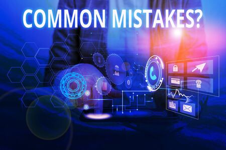 Word writing text Common Mistakes Question. Business photo showcasing repeat act or judgement misguided making something wrong Woman wear formal work suit presenting presentation using smart device Standard-Bild
