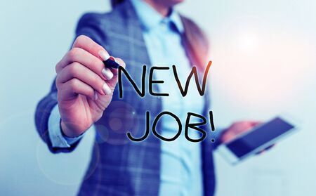 Text sign showing New Job. Business photo text recently having paid position of regular employment Business woman pointing in empty space with pen and mobile phone Stock Photo
