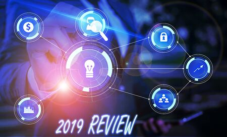 Writing note showing 2019 Review. Business concept for New trends and prospects in tourism or services for 2019 Male wear formal suit presenting presentation smart device