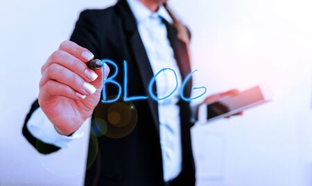 Writing note showing Blogquestion. Business concept for regularly updated website web page run by individual Digital business in black suite concept with business woman