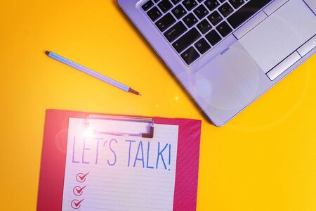 Writing note showing Let S Talk. Business concept for they are suggesting beginning conversation on specific topic Trendy metallic laptop clipboard paper sheet marker colored background